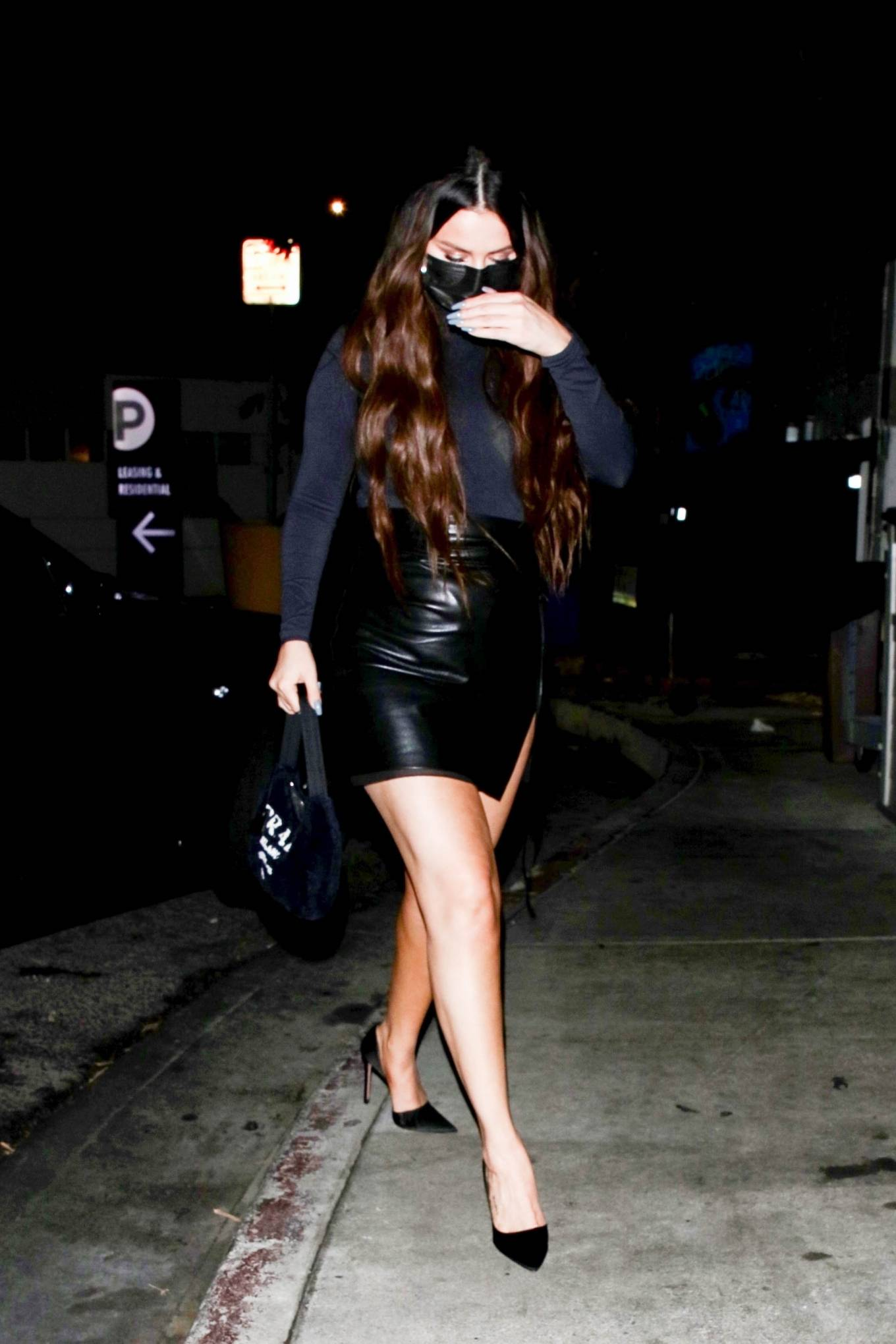 Selena Gomez wearing a figure hugging tucked in bodysuit that hugged her body in all the right places