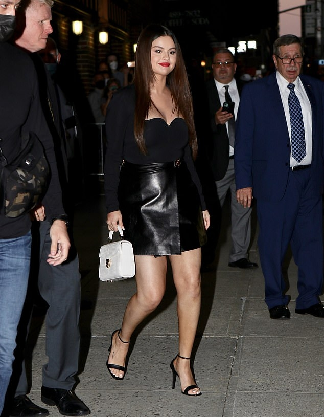 Selena Gomez donning a figure hugging Versace bodysuit with a viscose fabric, long sleeves and a sweetheart neckline