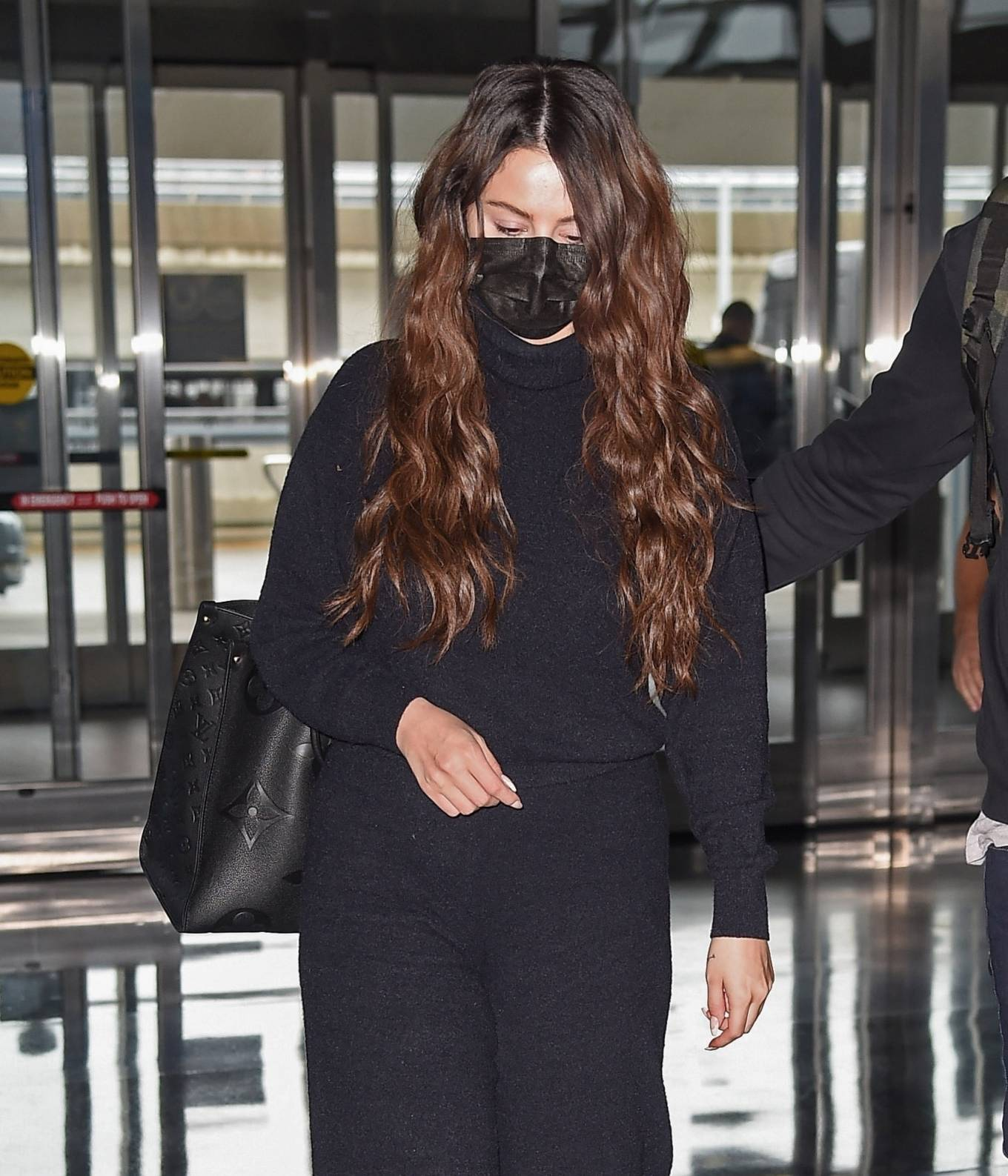 Selena Gomez wearing brand logo white Prada lace-up sneakers