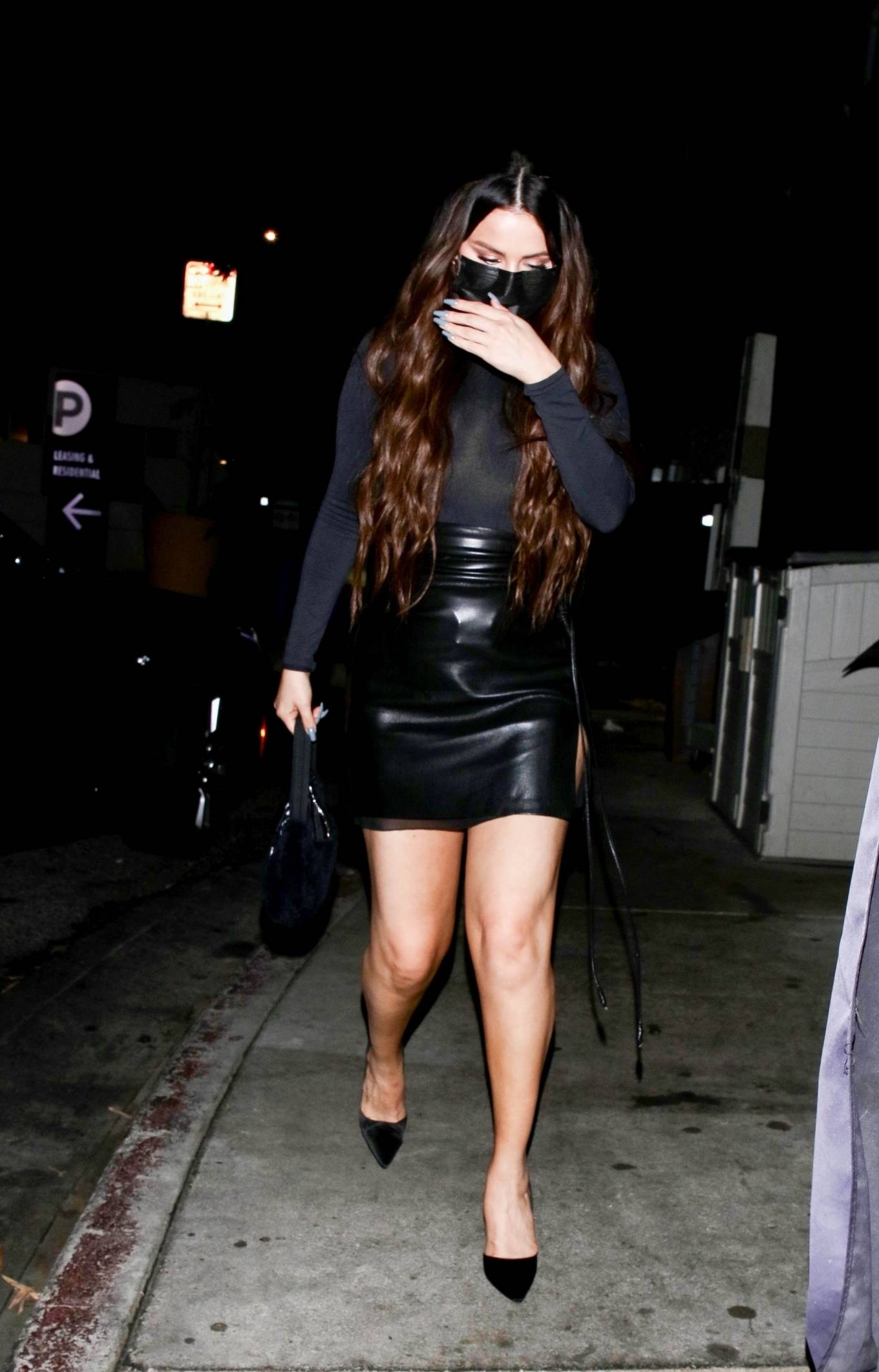 Selena Gomez rocking pointed black sandals with high heel