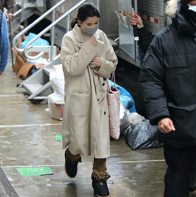 Selena Gomez rocking round black ankle boots