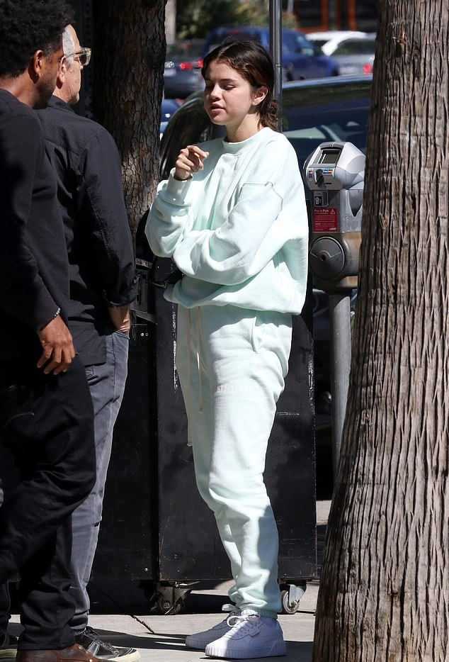 Selena Gomez rocking light sea green sweatpants with side pockets and a woolen material
