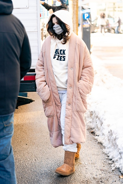 Selena Gomez wearing a relaxed fit baby pink hoodie with Cotton french terry, ripped cuffs and The Black Fives x PUMA collection label at front left pocket
