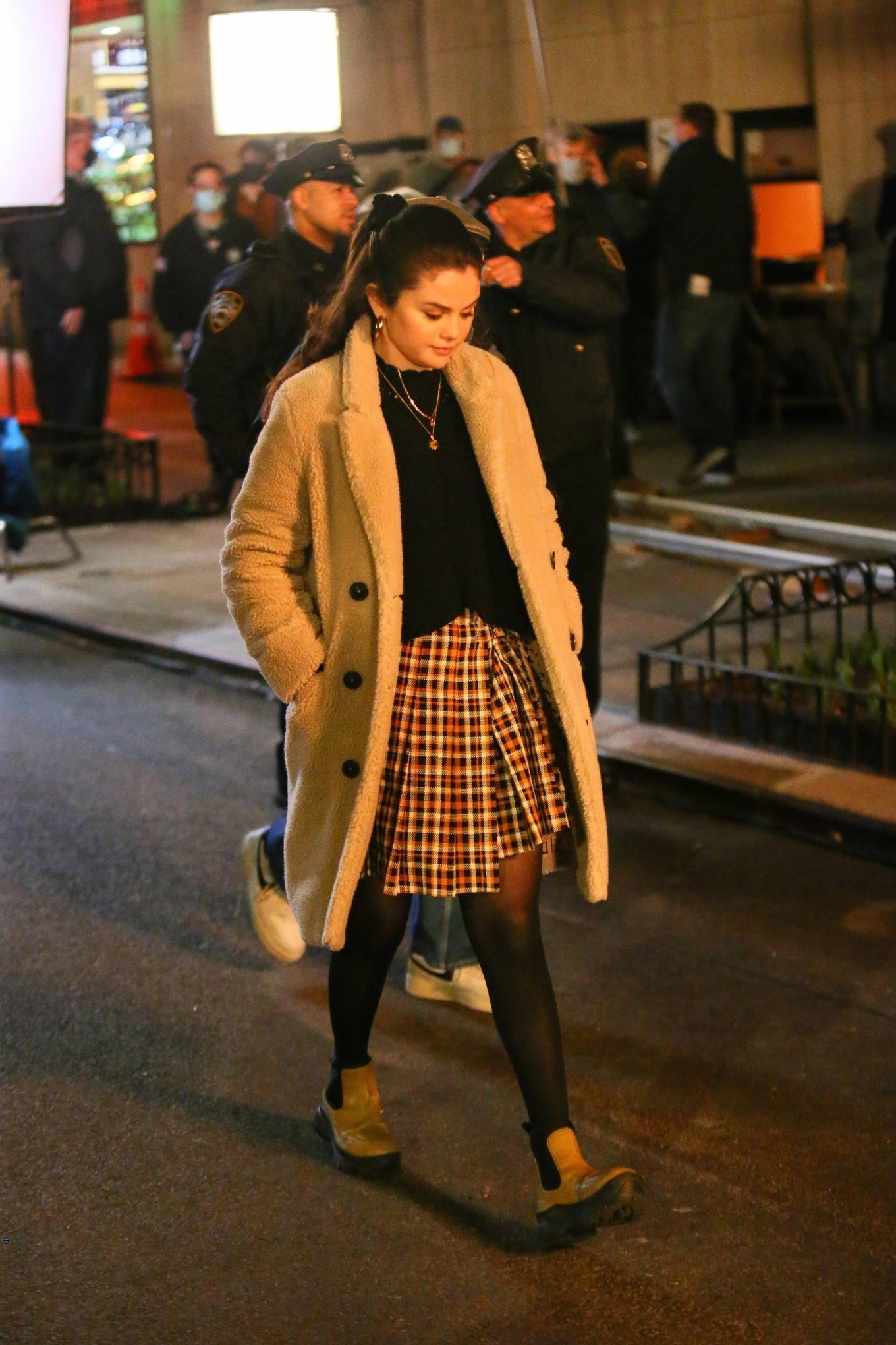 Selena Gomez rocking a oversized beige button front overcoat with a fleece fabric, full sleeves, lapel collar and side pockets