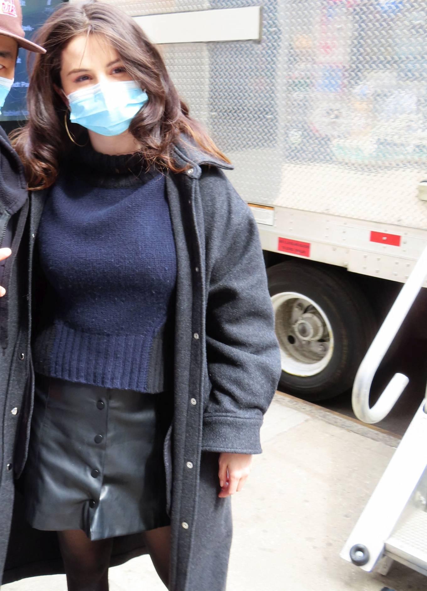 Selena Gomez rocking a black fitted leather mini skirt