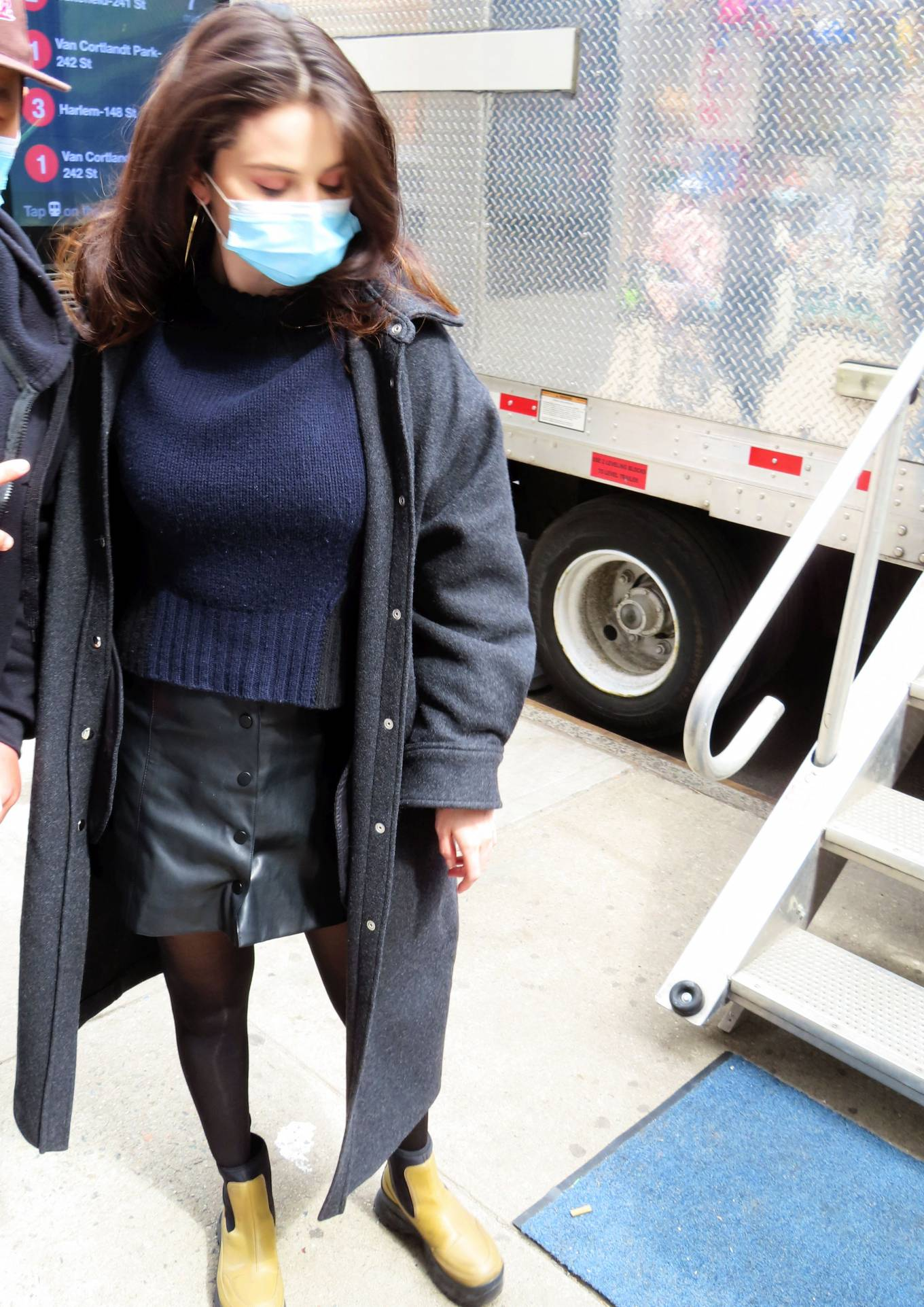 Selena Gomez, black mini skirt, leather, beige Stella McCartney boots, oversized black IRO jacket, mini, fitted, front button, navy blue sweater, black leggings. Selena Gomez rocking a black fitted leather mini skirt