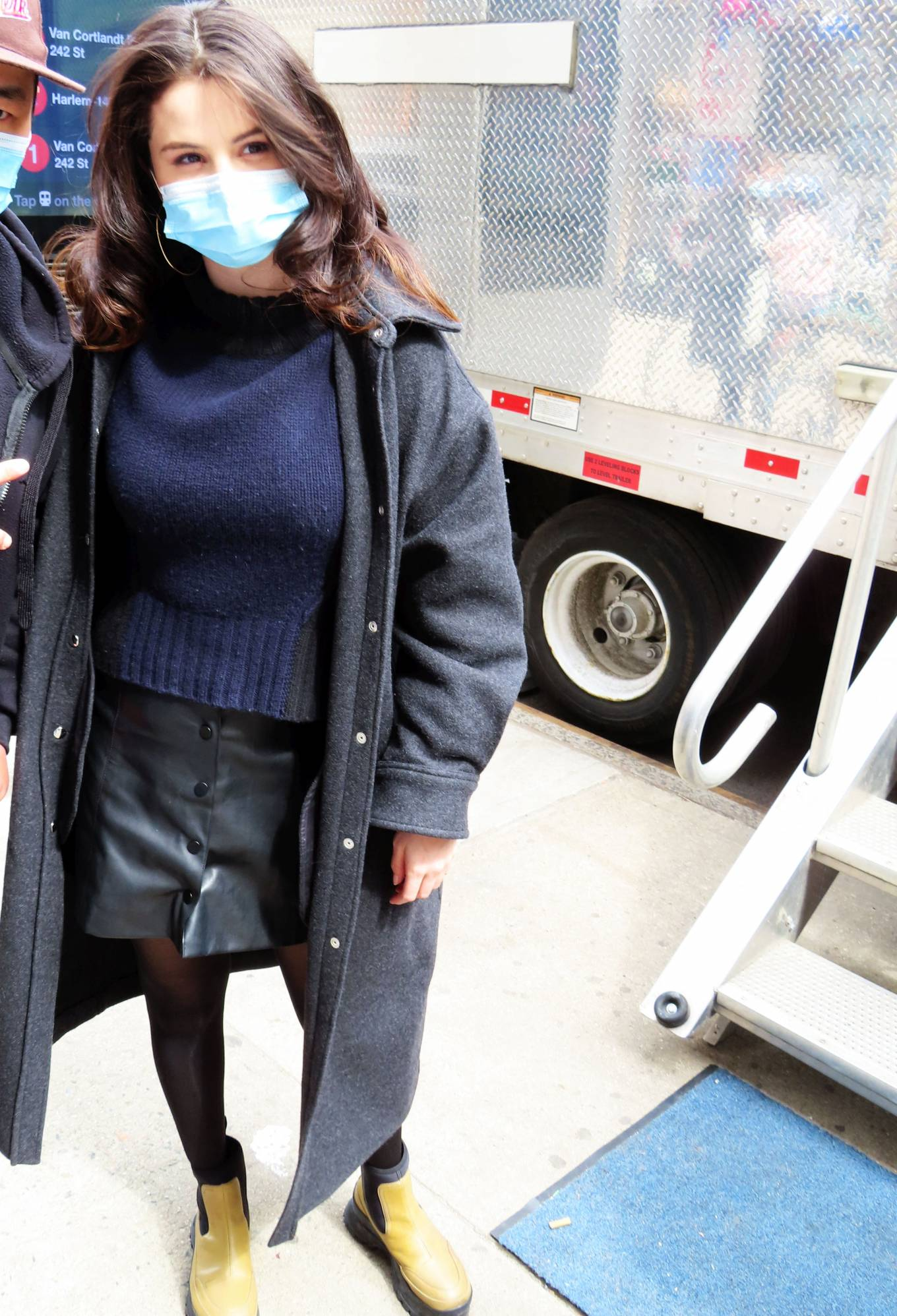 Selena Gomez, leather, black mini skirt, beige Stella McCartney boots, oversized black IRO jacket, fitted, front button, mini, navy blue sweater, black leggings. Selena Gomez rocking a black fitted leather mini skirt