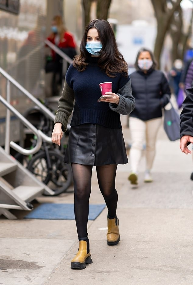 Selena Gomez wearing a black fitted leather mini skirt