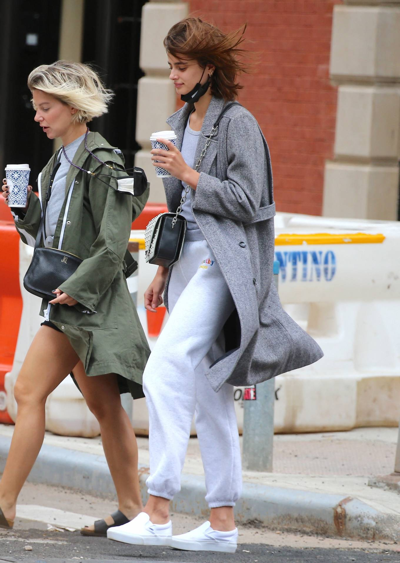 Taylor Hill donning round white Vans slip on sneakers with flat heel