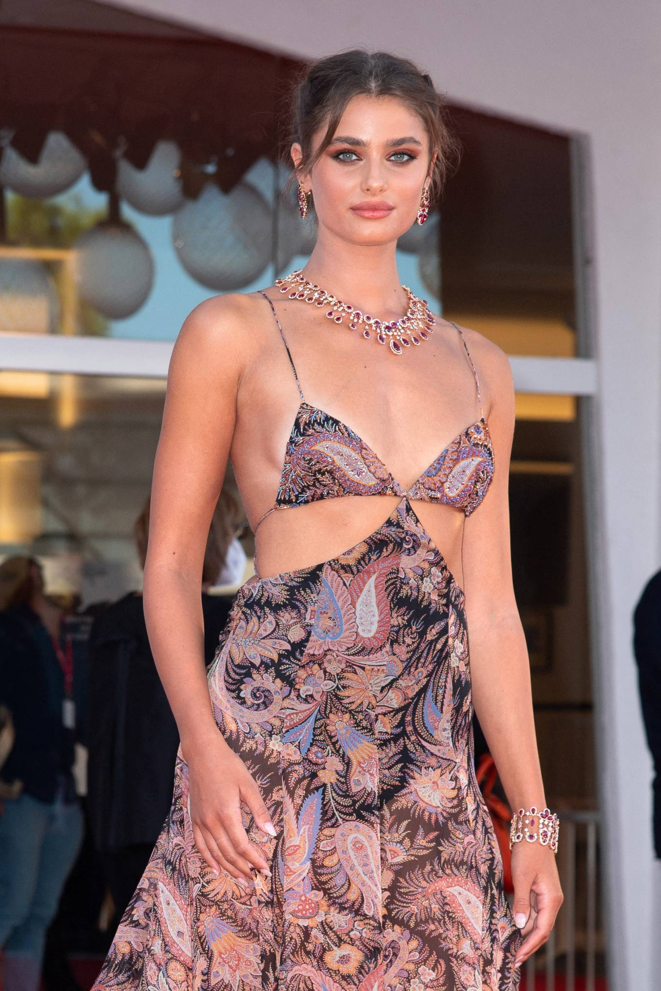 Taylor Hill rocking a Plunging mauve Etro paisley printed maxi dress with cut out, a V-neck, spaghetti straps and flared hem