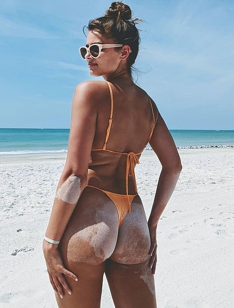 Taylor Hill wearing skimpy orange high rise bikini bottom
