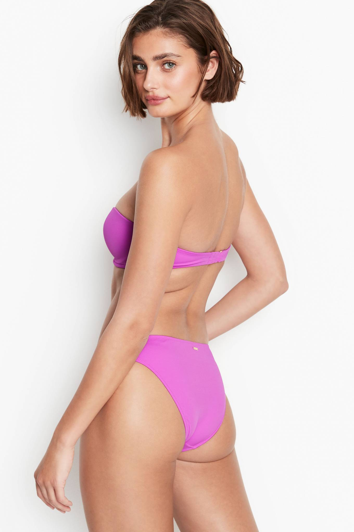 Taylor Hill donning a gorgeous pink bandeau with a nylon material and ruched