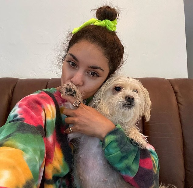 Vanessa Hudgens donning a Oversized yellow multi Max Roux tie dye sweatshirt with extra long sleeves and a crew neck