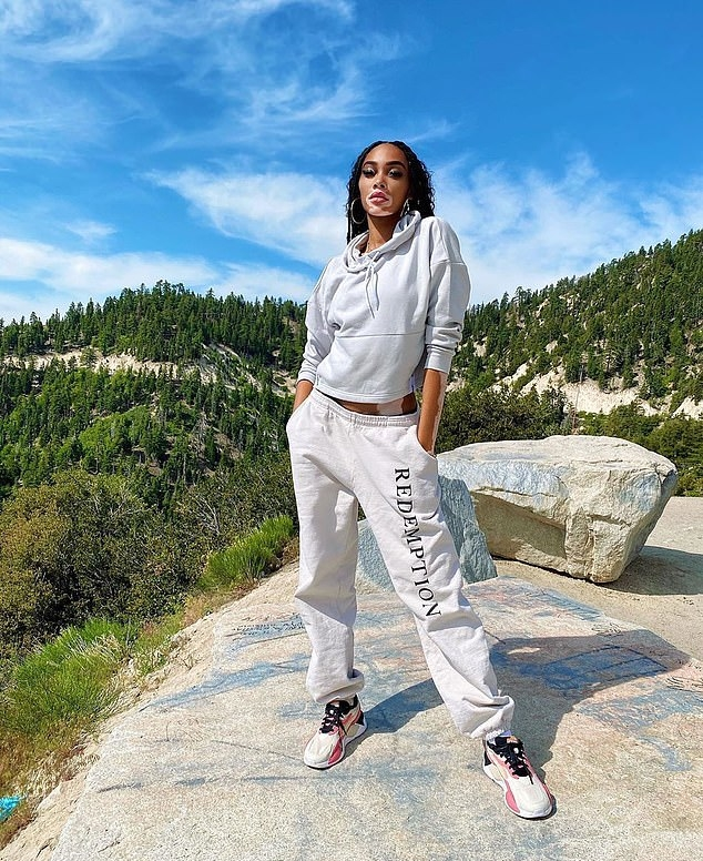 Winnie Harlow donning Grey baggy Redemption sweatpants with brand logo