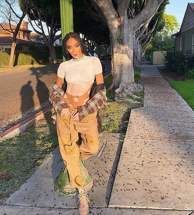 Winnie Harlow wearing chunky off white lace-up sneakers
