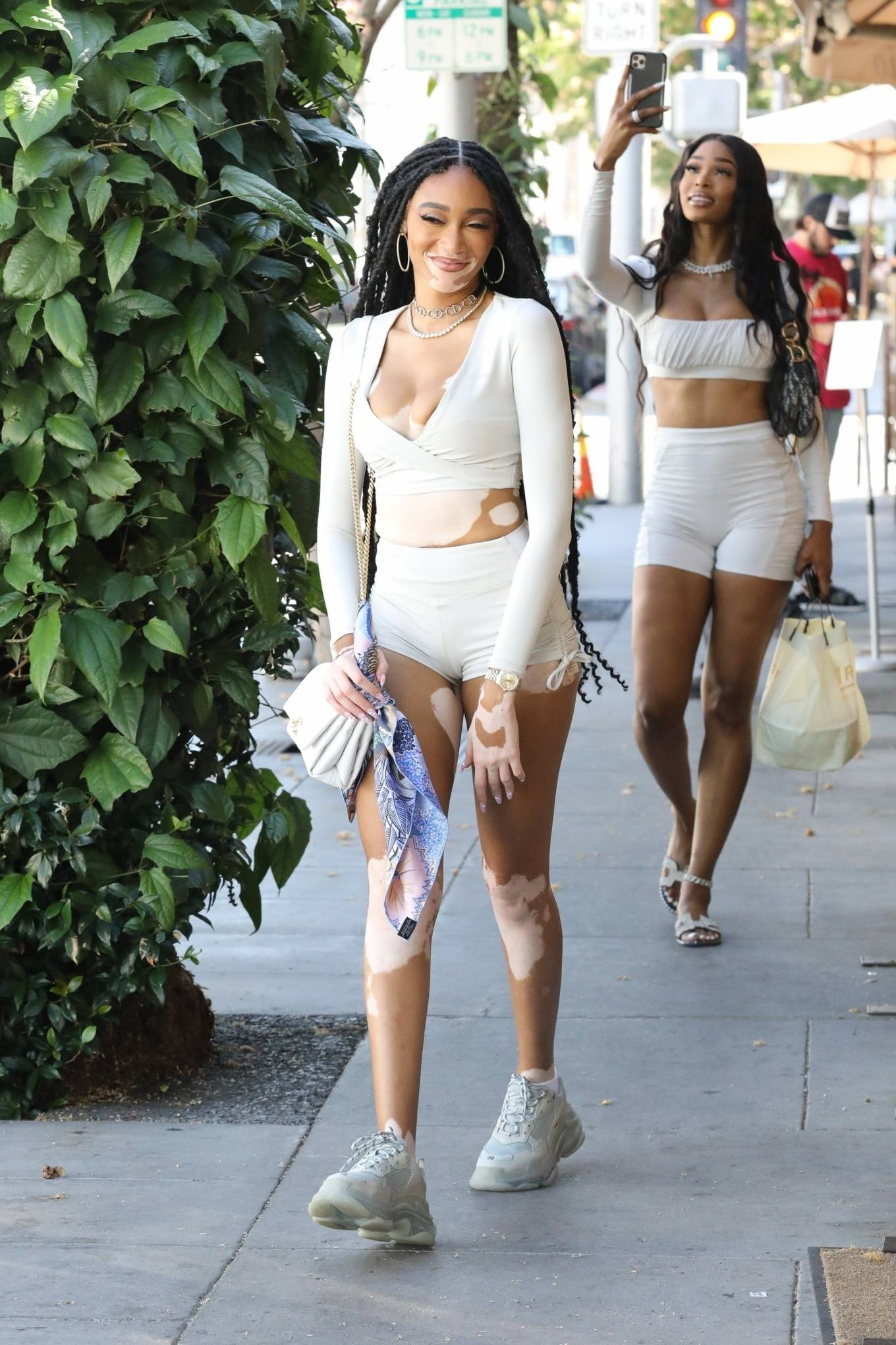 Winnie Harlow wearing skimpy white high rise bite shorts with a stretch fabric material