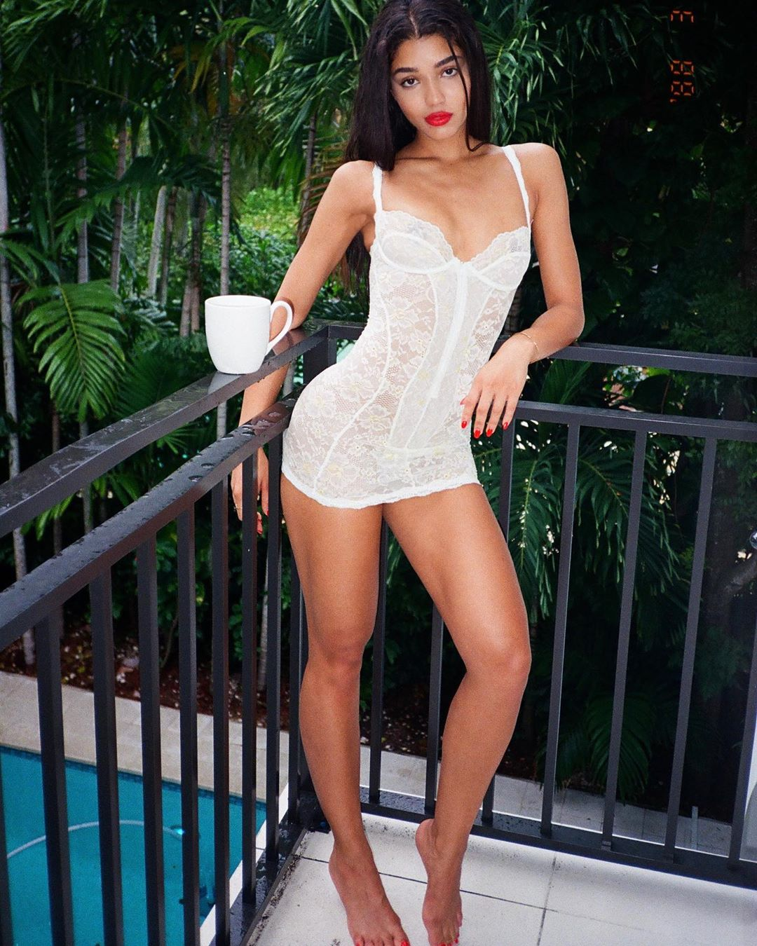 Yovanna Ventura rocking a White floral lace Savage X Fenty by Rihanna teddy with a lace detailing fabric, floral print, a very low cut sweetheart neckline and spaghetti straps