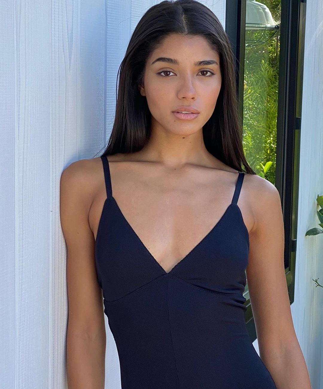 Yovanna Ventura donning chunky black mesh high top sneakers with contrasting sole