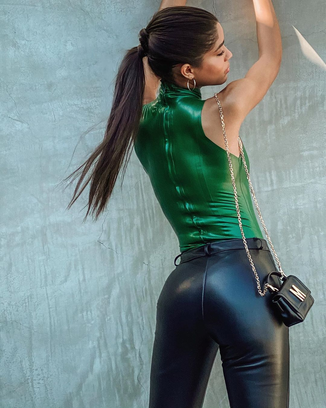 Yovanna Ventura wearing strappy black leather sandals with high heel