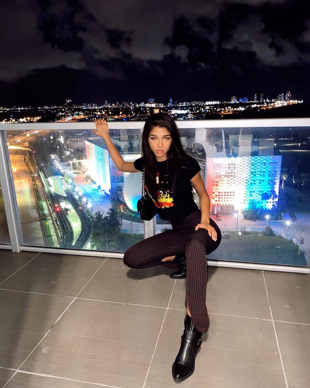 Yovanna Ventura donning pointy black leather boots